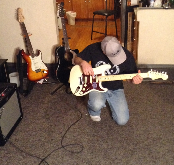 Ken Bacon winner of Melody Fusion Band Gear Giveaway 2014 with his Fender Strat